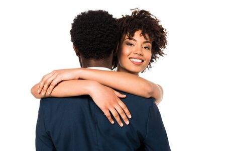 attractive and smiling african american woman hugging man isolated on white