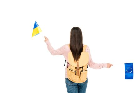 back view of student with backpack holding Ukrainian and European flags isolated on white