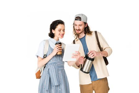 young man and girl looking at device, holding paper cup of coffee and  isolated on white