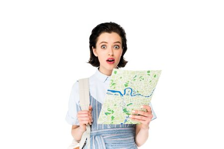 shocked girl holding map and looking at camera isolated on white