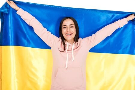 happy young girl holding satin flag of Ukraine isolated on white
