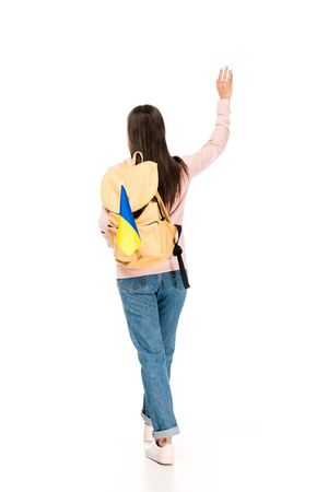 back view of student with backpack and Ukrainian flag waving hand isolated on white