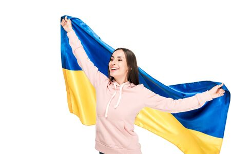 happy young girl holding flag of Ukraine isolated on white Фото со стока