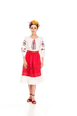 full length view of brunette young woman in national Ukrainian costume isolated on white 版權商用圖片
