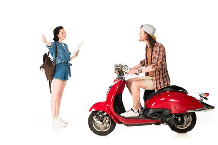 side view of  young man on red scooter and girl outstretched hand with thumb up isolated on white 免版税图像