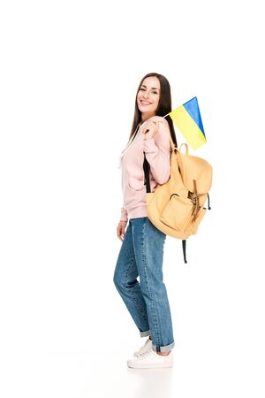 smiling student with backpack holding Ukrainian flag isolated on white