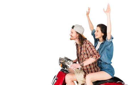 side view of girl with hands in air and young man sitting on red scooter isolated on white