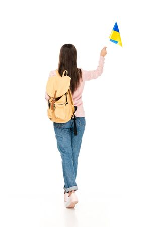 back view of student with backpack holding Ukrainian flag isolated on white Stock fotó