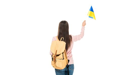 back view of student with backpack holding Ukrainian flag isolated on white Banco de Imagens