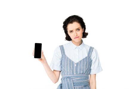 resentful beautiful girl showing smartphone at camera isolated on white Stock Photo
