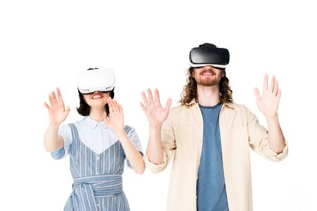young man and girl with VR headset raising hands in air isolated on white