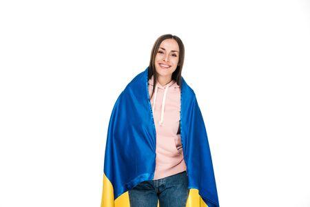 happy young girl holding satin flag of Ukraine isolated on white