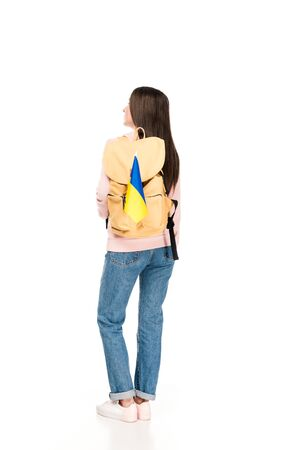 back view of student with backpack and Ukrainian flag isolated on white