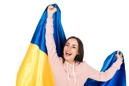 happy young girl holding satin flag of Ukraine and rejoicing isolated on white