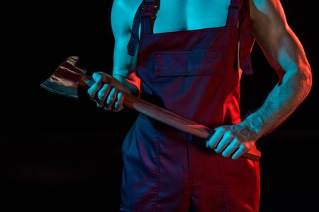 cropped view of sexy shirtless fireman in overall holding flat head axe isolated on black Reklamní fotografie