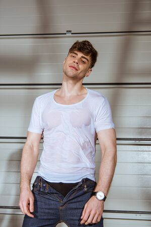 handsome man in jeans and wet white t-shirt Stock Photo - 128147139
