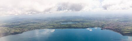 panoramic shot of aerial view of sea under blue sky with clouds in rome, italy