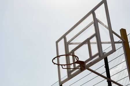basketball hoop at basketball court under sky in sunny day