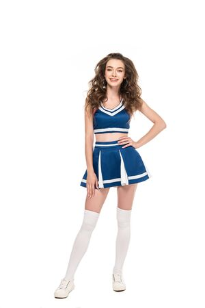 sexy happy cheerleader girl in blue uniform with hand on hip isolated on white Banque d'images - 128287867