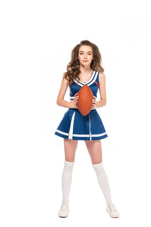 full length view of sexy cheerleader girl in blue uniform holding rugby ball isolated on white Banque d'images - 128191273