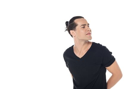 handsome curious brunette young man in black t-shirt looking away isolated on white