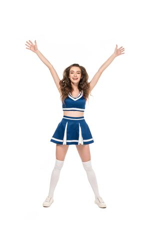 sexy happy cheerleader girl in blue uniform standing with hands in air isolated on white Banque d'images - 128192879
