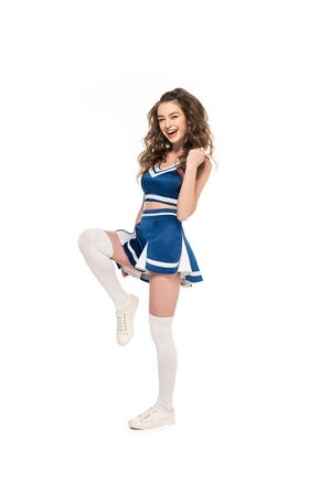 sexy happy cheerleader girl in blue uniform dancing isolated on white Stock Photo