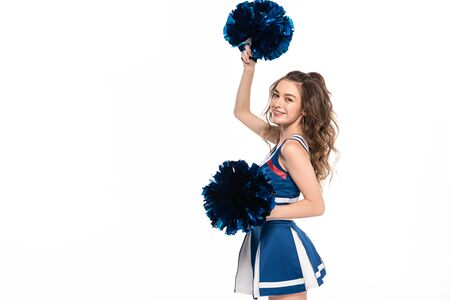 happy cheerleader girl in blue uniform dancing with pompoms isolated on white with copy space Banque d'images - 128191605