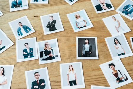 photos with men and women employees on wooden table