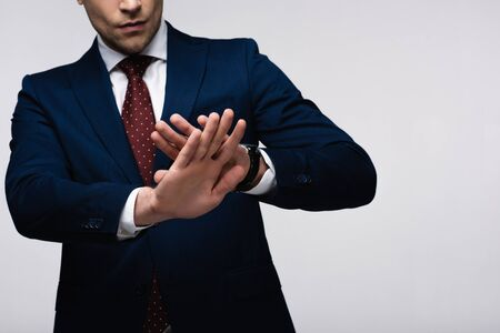 partial view of confident businessman showing refuse gesture isolated on grey, human emotion and expression concept Banco de Imagens