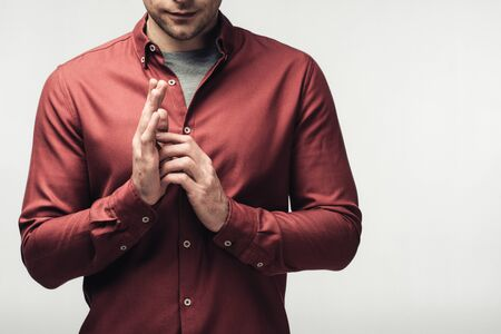 cropped shot of man in brown shirt gesturing with hands isolated on grey, human emotion and expression concept