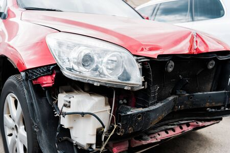 selective focus of damaged red automobile after car accident Imagens