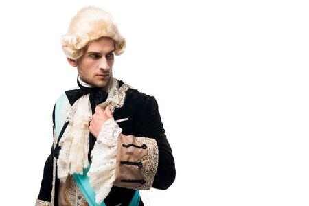 victorian gentleman in wig in formal wear standing isolated on white Reklamní fotografie