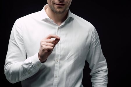 cropped view of businessman gesturing with hand while using body language isolated on black, human emotion and expression concept Stockfoto