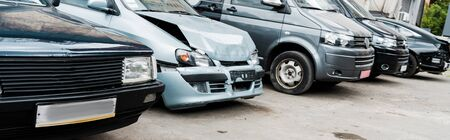 panoramic shot of damaged vehicle after car accident near modern automobiles Imagens