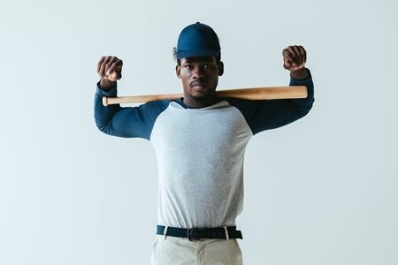 confident african american sportsman with baseball bat looking at camera isolated on grey 스톡 콘텐츠