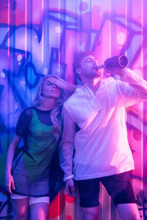 attractive and blonde woman with closed eyes and handsome man drinking champagne Stok Fotoğraf