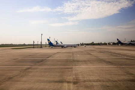 ROME, ITALY - JUNE 28, 2019: airplanes at aerodrome under sky with white clouds