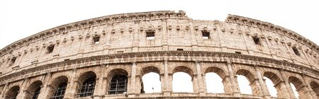 ROME, ITALY - JUNE 28, 2019: panoramic shot of ruins of colosseum