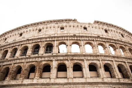 ROME, ITALY - JUNE 28, 2019: ruins of colosseum under grey sky 報道画像