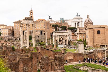 ROME, ITALY - JUNE 28, 2019: crowd of tourists walking at roman forum Éditoriale