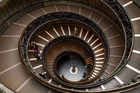 ROME, ITALY - JUNE 28, 2019: overhead view of people on Bramante Staircase in vatican museums