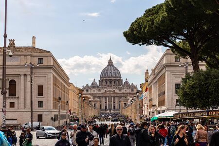 ROME, ITALY - JUNE 28, 2019: crowd of tourists in front of Basilica of st. peter