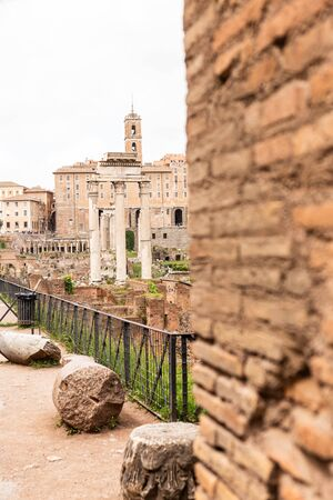ROME, ITALY - JUNE 28, 2019: selective focus of ancient ruined buildings