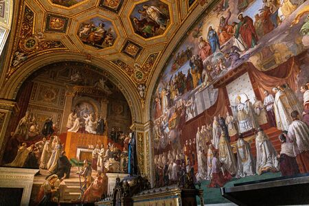 ROME, ITALY - JUNE 28, 2019: ancient frescoes and statue in vatican museums