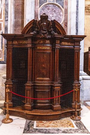ROME, ITALY - JUNE 28, 2019: confession booth in basilica of St. Peter in Vatican