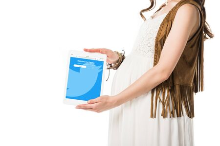 KYIV, UKRAINE - FEBRUARY 4, 2019: cropped view of pregnant woman holding digital tablet with twitter app on screen isolated on white Editorial