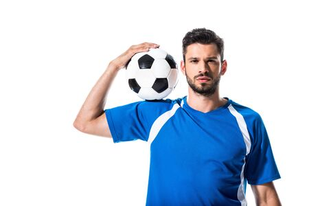 handsome soccer player looking at camera and holding ball Isolated On White