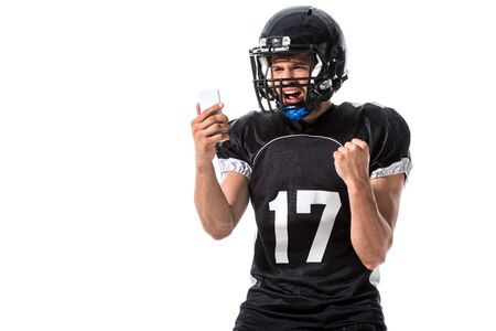 yelling American Football player with smartphone Isolated On White Фото со стока