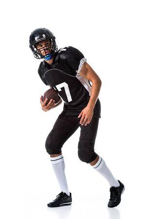 American Football player holding ball On White Фото со стока